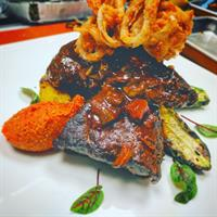 Braised Beef Short Rib/Grilled Polenta/Zucchini/Romesco/Onion Fry
