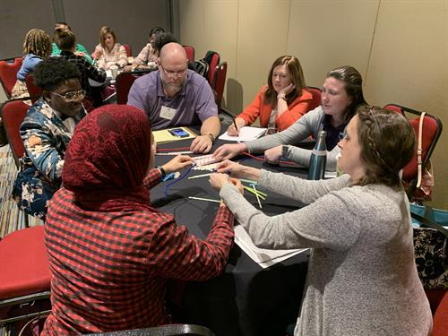 Conference attendees connect through team-building activities - Culture-focused strategies