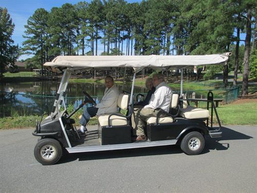 The residents love to take golf cart rides around the grounds.