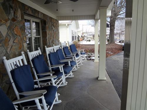 Our front porch is just waiting for you to come and sit a while.