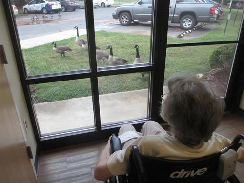 One of our Memory Care residents is enjoying some visitors.