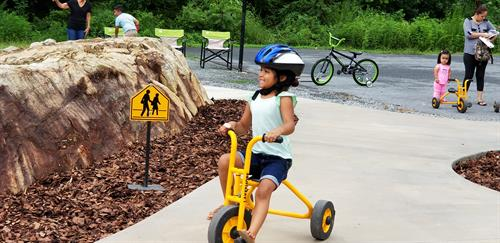 Outdoor Learning Environments promote exploration, socialization, and active play.