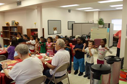 Head Start children entertaining the Senior Service Meal Site