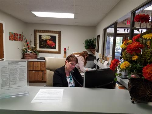 Chris, our Director of First Impressions, answering your calls at our busy front desk!