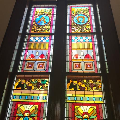 Stained glass windows in the Meetinghouse