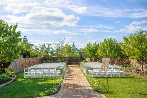 Whimsical Ceremony Site with Bright Greens