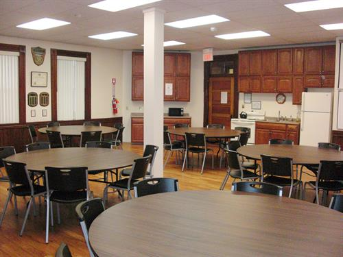 Our most popular party room, room 1 has a full kitchen and large round tables.