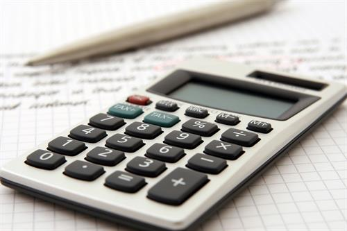 Gallery Image Canva_-_Calculator_on_Accounting_Workspace.jpg