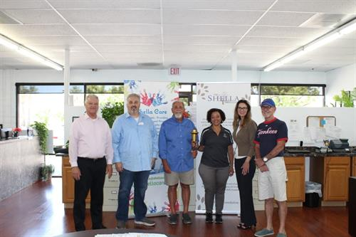 The Shella Foundation provided sponsorship for the 2019 Torch Run to support individuals with disabilities. The board members with a representative from the Torch Run.