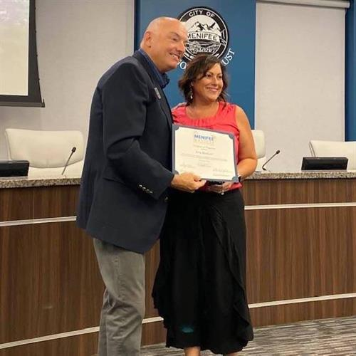 Amy with Mayor Zimmerman receiving her Certificate for achievement of the Menifee Masters and becoming a Residential Real Estate Ambassador for Menifee