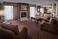 Our penthouse suite has a spacious living room and dining for 6 people.