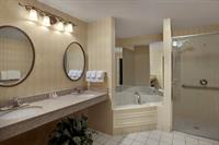 Penthouse: En suite bathroom with jet bath tub.