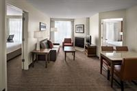 Two bedroom suites have two separate bedrooms, each with a queen bed, located off of the centrally located living room.