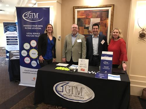 GTM staff at a CRHRA event sponsored by GTM.