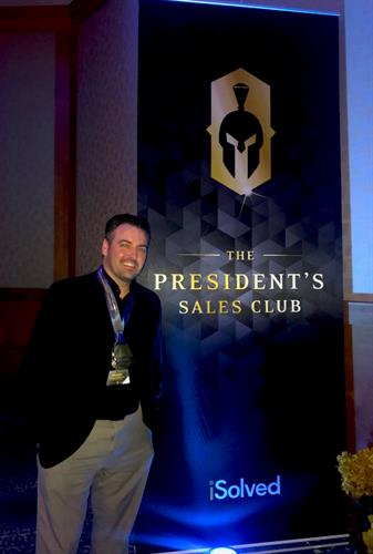 Michael Maddalone, Director of Business Sales, wins the Presidents Club Award for sales from iSolved.