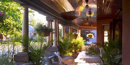 Relax on Union Gables Inn wrap around front porch