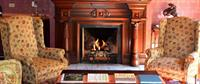 Fireplace in living room at Union Gables Inn