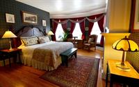 Kate room with a king bed and fireplace at Union Gables Inn