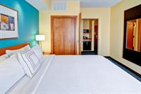Standard Room with one king size bed. Room includes microwave and refrigerator