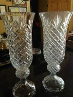 "two vases: one not cleaned, one cleaned and polished.  Crystal should be ""crystal clear"""