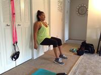 Wall squats with client Melissa