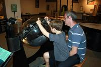 Father and son learn about faults in the exhibit Earth Exposed: Discovery Our Planet's Hidden Secrets