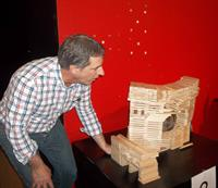 Participants in the KEVA plank architect build enjoy the end of the competition by finding innovative means to knock down their structures