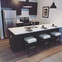 Kitchen includes Stainless Steel Appliances and Quartz Countertops