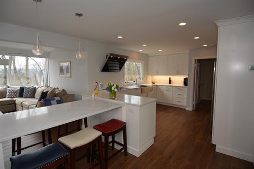 Sleek White Contemporary Kitchen with European Flare   Design by Arthur Zobel