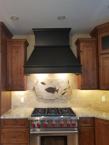 50 million year old fish fossils add character to this Adirondack kitchen