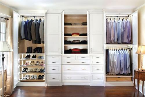 Custom closets provide exacting wardrobe storage    Design by Arthur Zobel