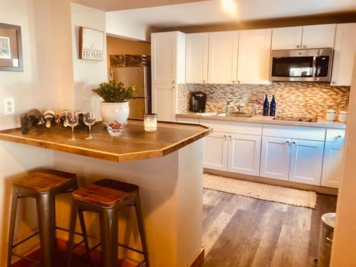 Newly renovated kitchen in our guest suite
