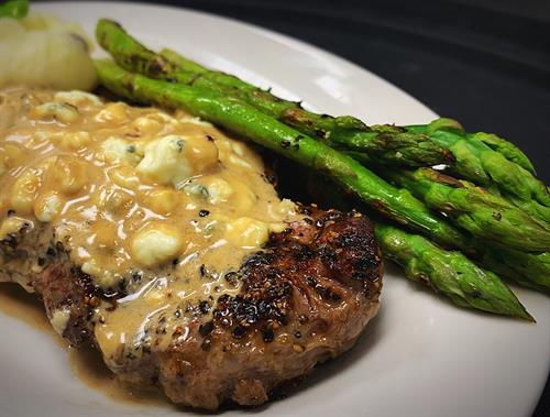 Customize a Strip Steak the way you like it. Cooked to perfection, and we offer multiple options to top it with