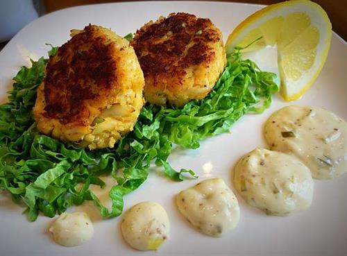 Start of with an order of our homemade Crab Cakes