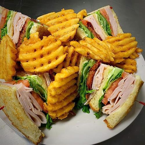 Turkey Club served with our waffle fries