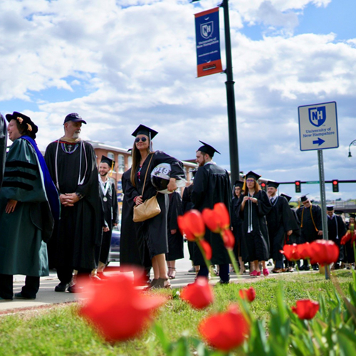 UNH Manchester graduates en route to commencement to celebrate their achievements.