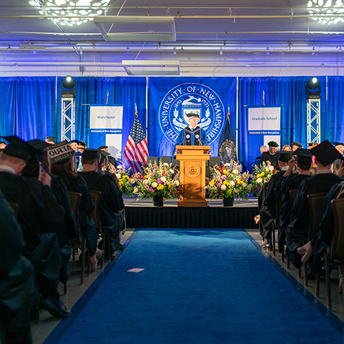UNH President James Dean addresses graduates at UNH Manchester's commencement ceremony.