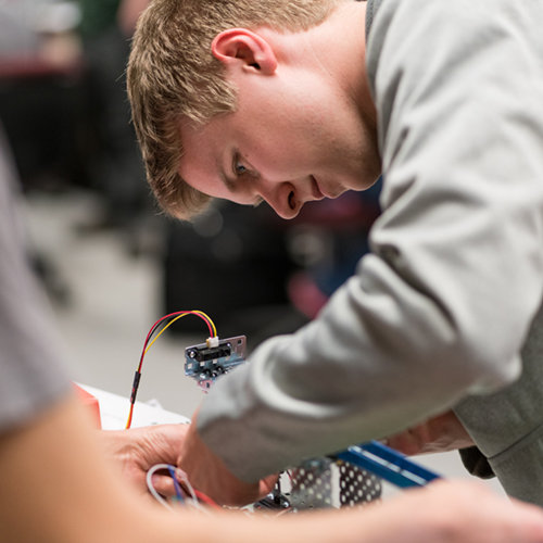 UNH Manchester student gets hands-on experience in electrical engineering technology.