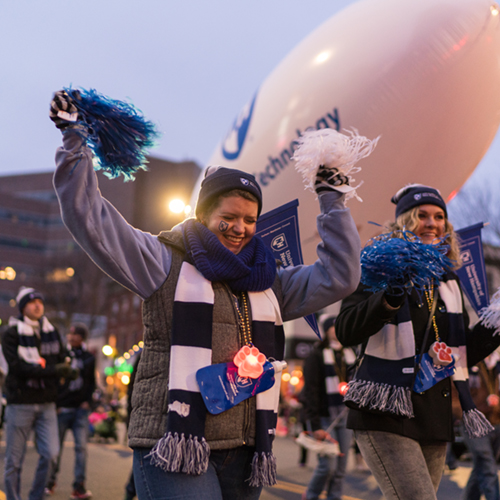UNH Manchester students, faculty, staff and friends leading the Manchester Christmas parade.