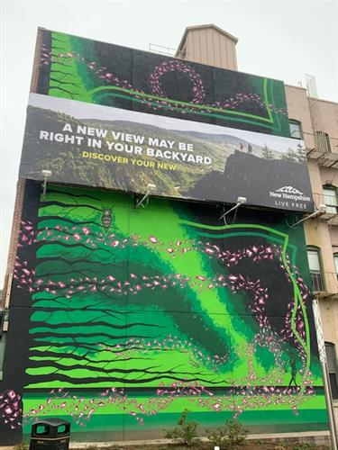The wallscape on the corner of Bridge St. and Elm St. draws the eye to this billboard even more.