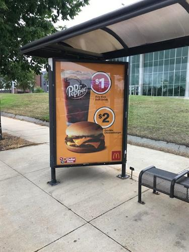 Bus shelters are great street level mini-billboards.