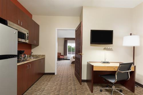 Each spacious room comes equipped with a microwave, refrigerator, and sofa bed.