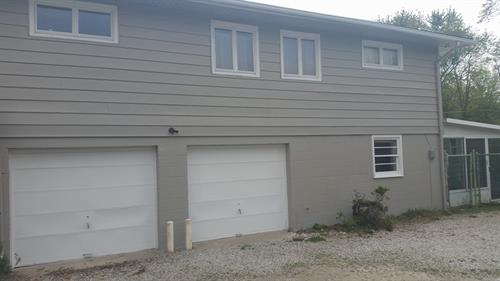 This home went from dull and white to a fresh new start with our exterior painting services