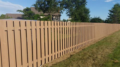 An old worn fence went from old to new with our fence painting services