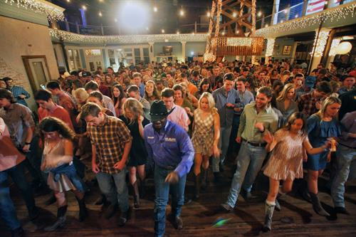 Ira Bradford line dancing with 500 Baylor college students