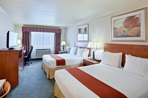One of our comfortable double queen rooms. Perfect for your family!