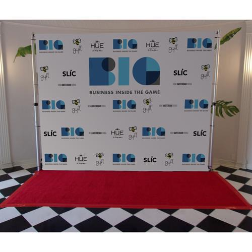 Step and repeat backdrop, pipe and base stand, and red carpet