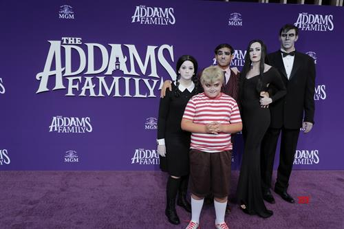 Addams Family media wall with custom lettering and custom purple carpet