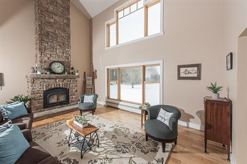 Great room - relax next to the fire or watch the leaves fall during the fall months.