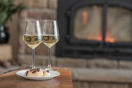 Enjoy some wine next to the fireplace